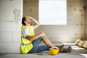 Worker feeling pain on his knees due to accident.